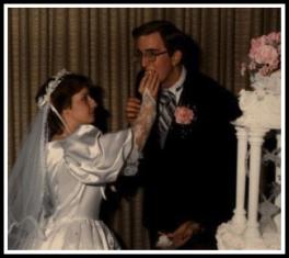wedding_suz_stuffs_david_with_cake_web